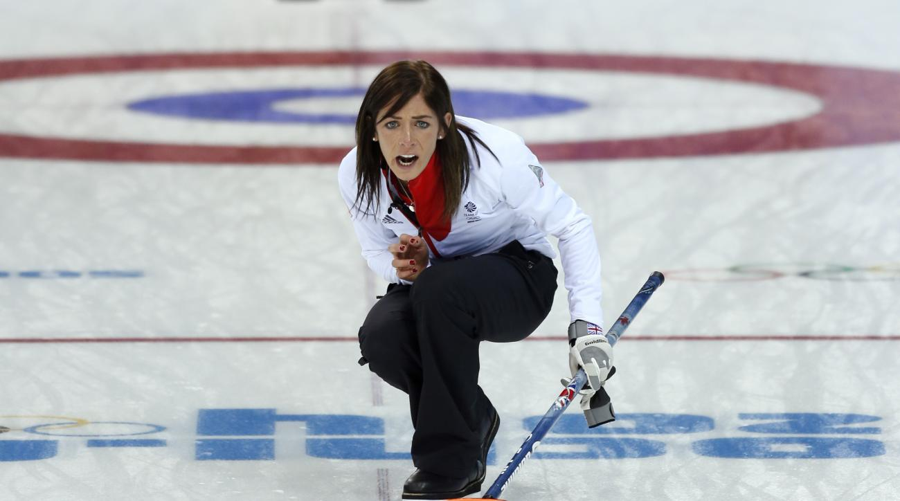 Great Britain's skip Eve Muirhead shouts instructions to her sweepers after delivering the rock in during women's curling competition against Canada at the 2014 Winter Olympics, Wednesday, Feb. 12, 2014, in Sochi, Russia. (AP Photo/Robert F. Bukaty)