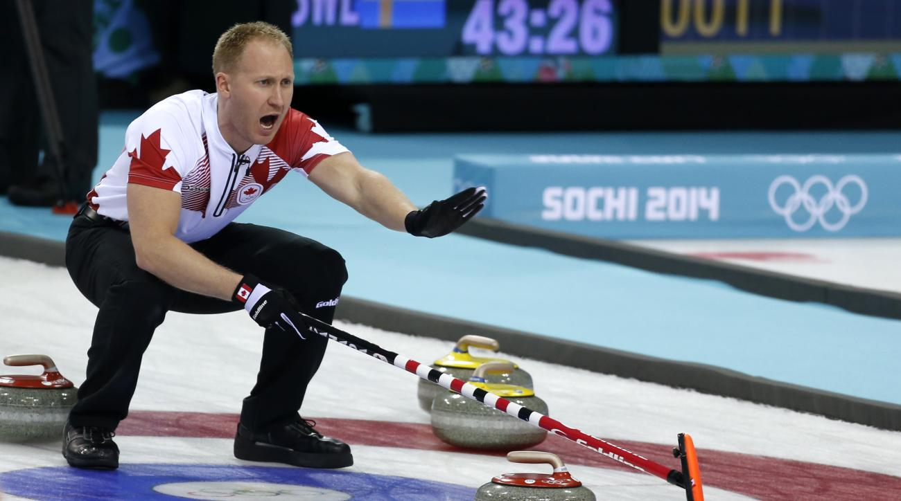Canada's skip Brad Jacobs shouts instructions from the house during curling competition against Russia at the 2014 Winter Olympics, Wednesday, Feb. 12, 2014, in Sochi, Russia. (AP Photo/Robert F. Bukaty)