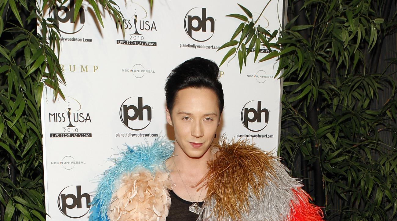 In this May 16, 2010 photo, Johnny Weir arrives at the Miss USA 2010 pageant, in Las Vegas. Behind a microphone, Weir is fearless - just as he was throughout a skating career that began perilously late, probably peaked too early, and almost certainly would have garnered more ribbons, titles (he won three national championships) and Olympic medals (zero) if only he'd been less confrontational. Yet that attitude, coupled with a fierce intelligence and a love of fashion that began with childhood and still knows no bounds, is what made Weir a first-class commentator from the very beginning.(AP Photo/Isaac Brekken)