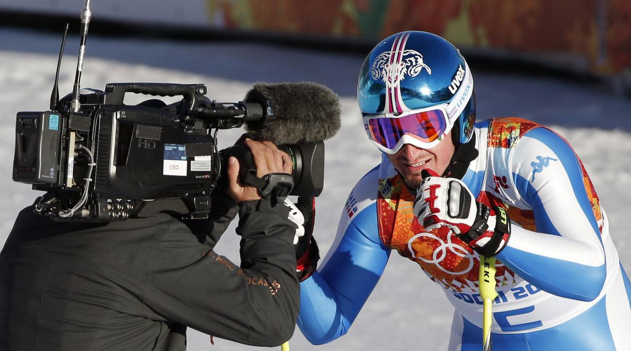 Italy's Dominik Paris smiles for the camera after completing men's downhill combined training at the Sochi 2014 Winter Olympics, Thursday, Feb. 13, 2014, in Krasnaya Polyana, Russia. (AP Photo/Christophe Ena)