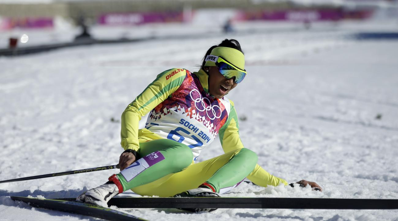 Togo's Mathilde Amivi Petitjean sits on the snow after completing in the women's 10K classical-style cross-country race at the 2014 Winter Olympics, Thursday, Feb. 13, 2014, in Krasnaya Polyana, Russia. (AP Photo/Gregorio Borgia)