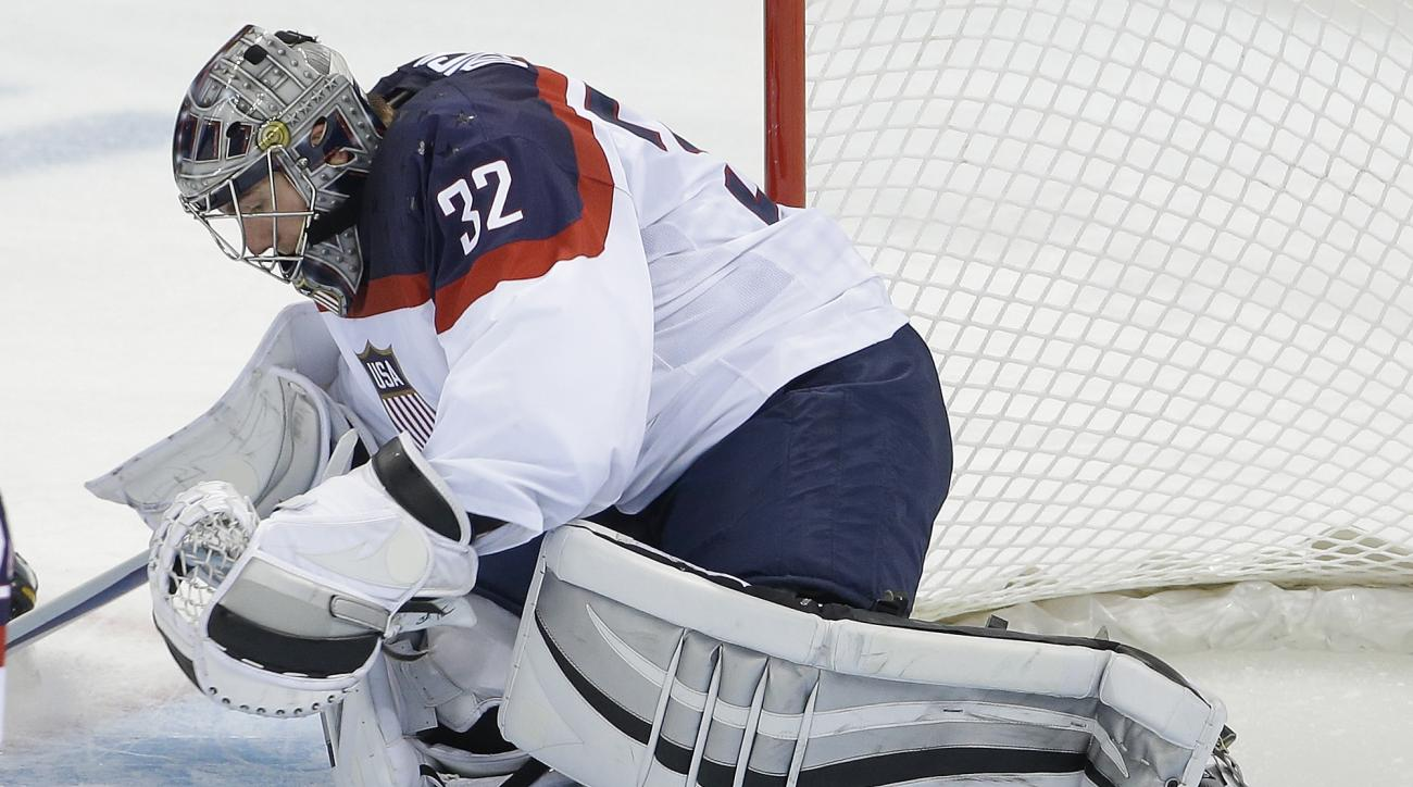 USA goaltender Jonathan Quick dives on the puck during the second period of the game against Slovakia during the 2014 Winter Olympics men's ice hockey tournament at Shayba Arena, Thursday, Feb. 13, 2014, in Sochi, Russia. (AP Photo/Matt Slocum)