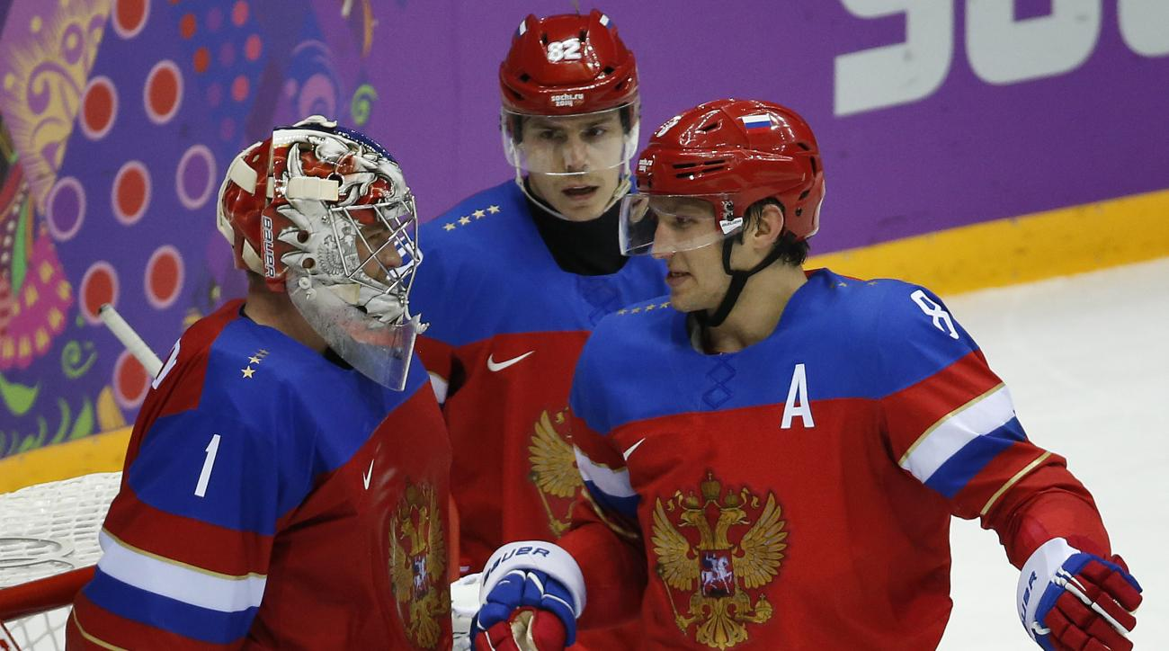 Russia forward Alexander Ovechkin, right, greets Russia goaltender Semyon Varlamov after Russia defeated Slovenia 5-2 in a men's ice hockey game at the 2014 Winter Olympics, Thursday, Feb. 13, 2014, in Sochi, Russia. (AP Photo/Mark Humphrey)