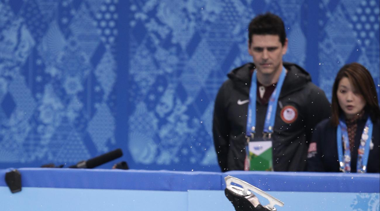 Jeremy Abbott of the United States falls as he competes in the men's short program figure skating competition at the Iceberg Skating Palace during the 2014 Winter Olympics, Thursday, Feb. 13, 2014, in Sochi, Russia. (AP Photo/Bernat Armangue)