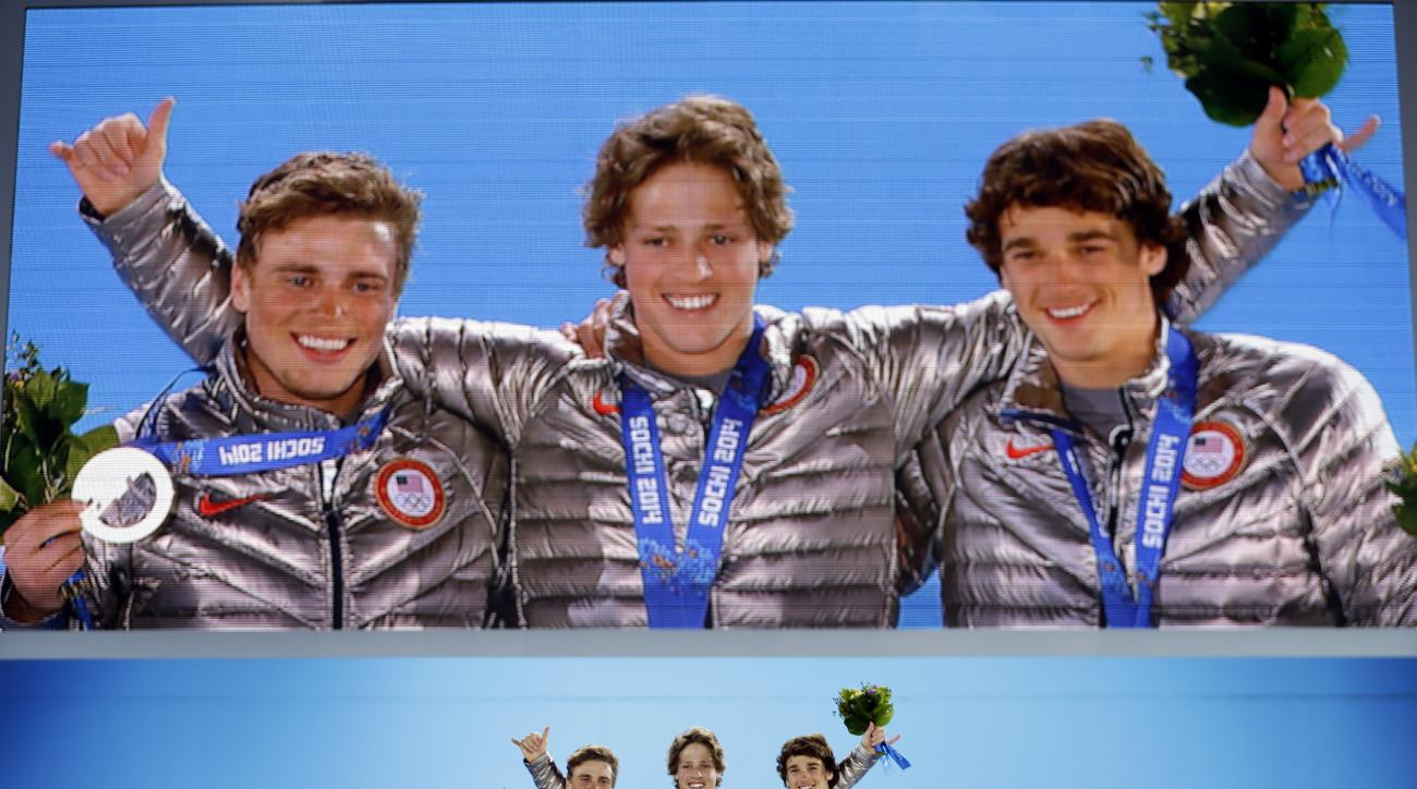 Men's slopestyle skiing medalists, from left, Gus Kenworthy, silver, Joss Christensen, gold, and Nicholas Goepper, bronze, all from the United States, pose with their medals at the 2014 Winter Olympics in Sochi, Russia, Thursday, Feb. 13, 2014.  (AP Photo/David Goldman)