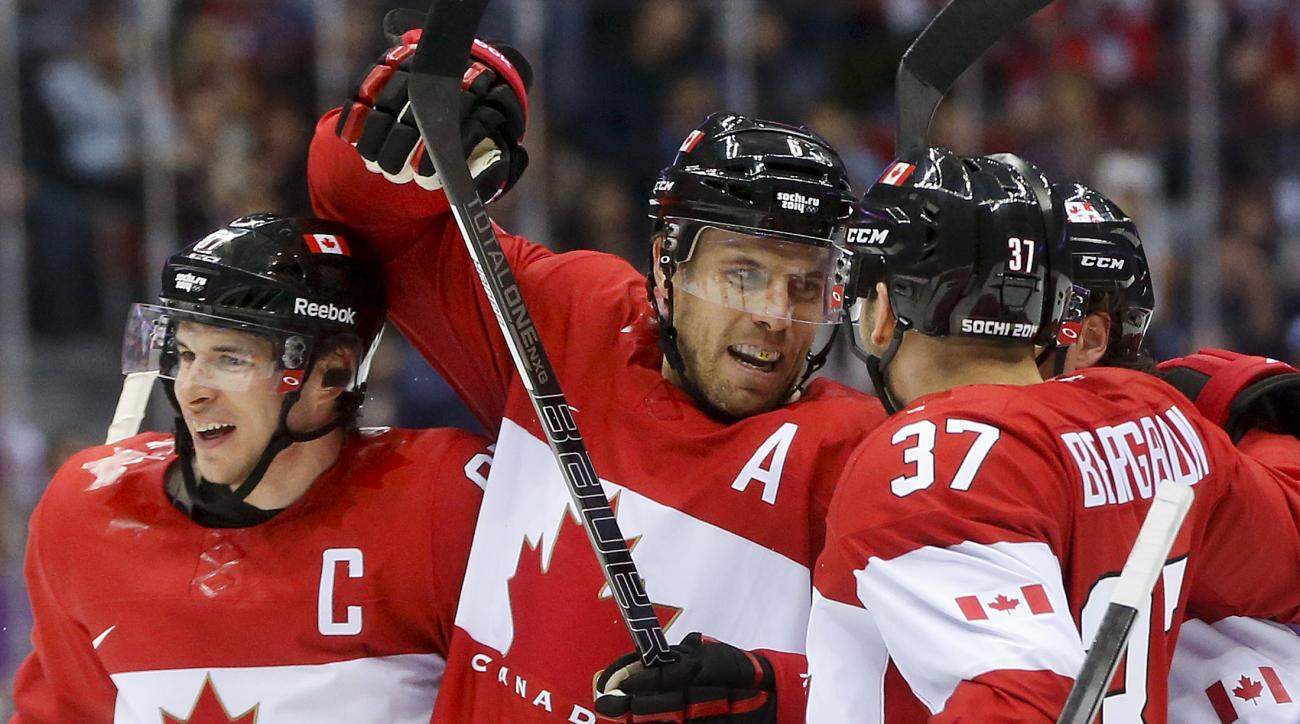Canada defenseman Shea Weber, center, celebrates with forward Sidney Crosby, left, and forward Patrice Bergeron after scoring a goal against Norway in the second period of a men's ice hockey game at the 2014 Winter Olympics, Thursday, Feb. 13, 2014, in Sochi, Russia. (AP Photo/Julio Cortez)