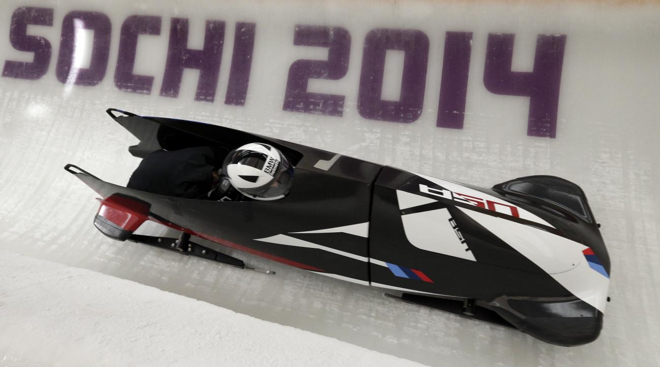 Elena Meyers and Katie Eberling of the United States take a turn during a training session for the women's bobsleigh at the 2014 Winter Olympics,  Friday, Feb. 14, 2014, in Krasnaya Polyana, Russia. (AP Photo/Michael Sohn)