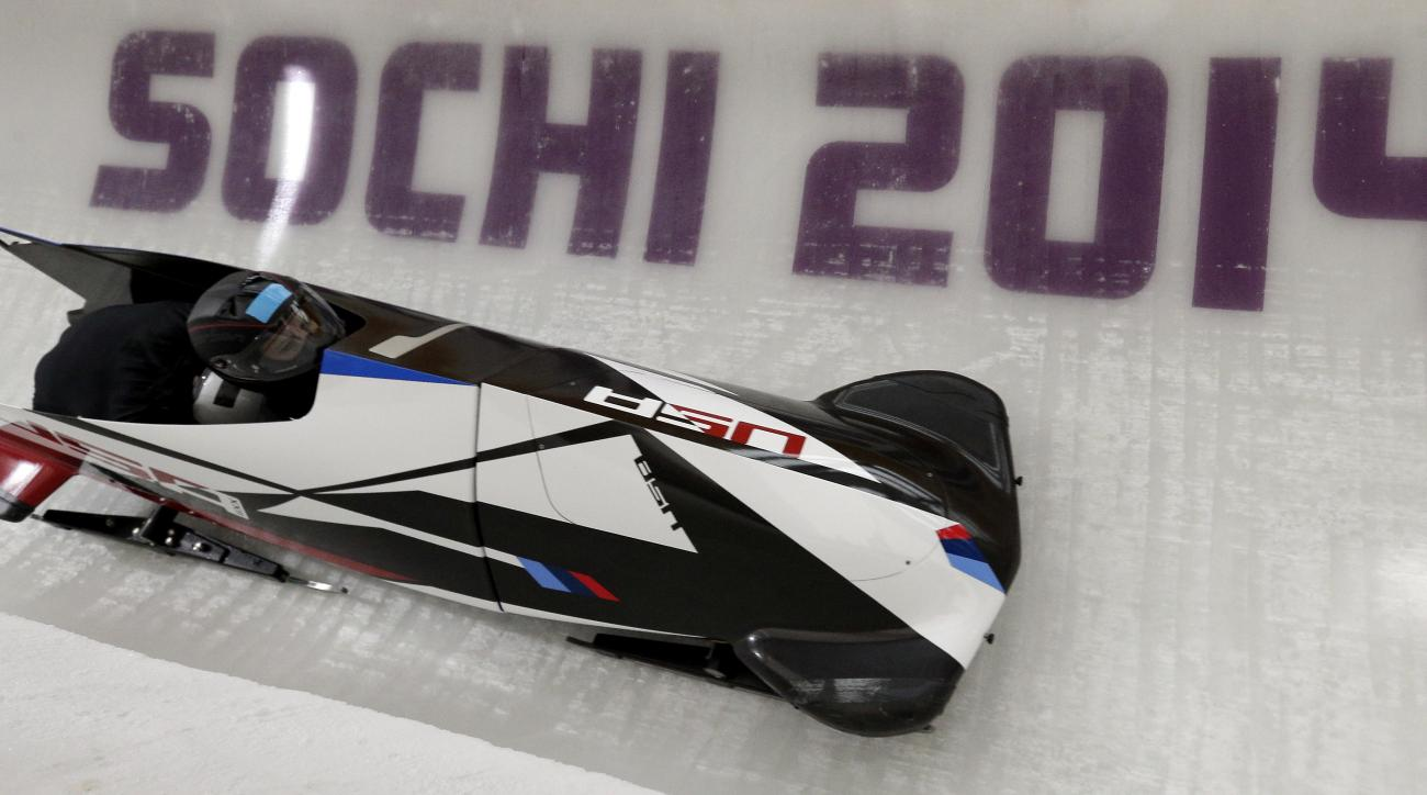 Jamie Greubel and Aja Evans of the United States take a turn during a training session for the women's bobsleigh at the 2014 Winter Olympics,  Friday, Feb. 14, 2014, in Krasnaya Polyana, Russia. (AP Photo/Michael Sohn)