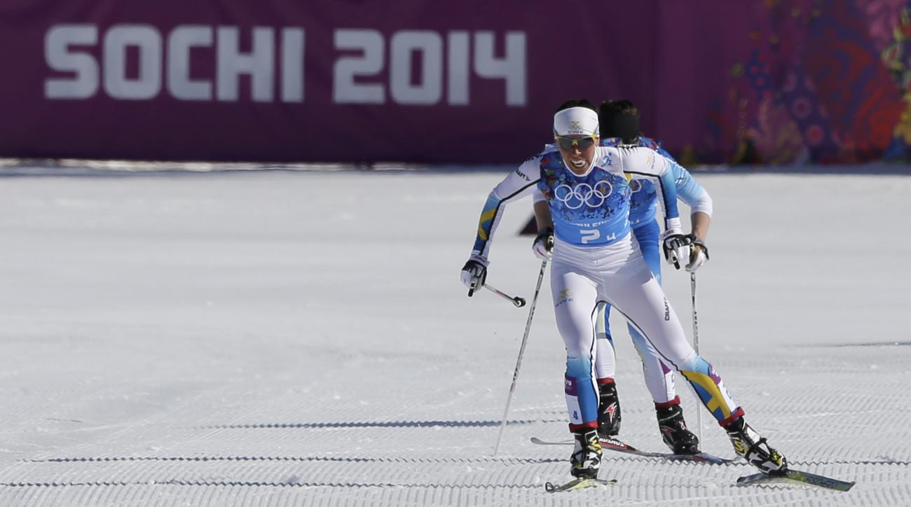 Sweden's Charlotte Kalla ski to winning the gold during the women's 4x5K cross-country relay at the 2014 Winter Olympics, Saturday, Feb. 15, 2014, in Krasnaya Polyana, Russia. (AP Photo/Matthias Schrader)