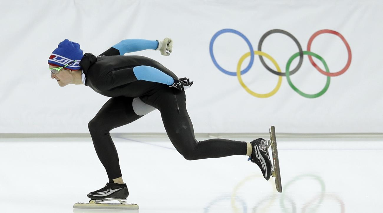 U.S. Speedskater Jonathan Kuck warms-up wearing the old World Cup race suit, prior to the men's 1,500-meter race at the Adler Arena Skating Center during the 2014 Winter Olympics in Sochi, Russia, Saturday, Feb. 15, 2014. U.S. skaters are looking to bounce back from an awful start to their Olympics by slipping back into their old suits that should have been made obsolete by new high-tech gear. (AP Photo/Patrick Semansky)
