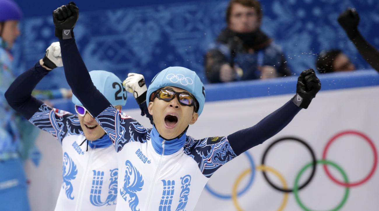 Victor An of Russia, right, celebrates winning in a men's 1000m short track speedskating final alongside Vladimir Grigorev of Russia, who placed second, at the Iceberg Skating Palace during the 2014 Winter Olympics, Saturday, Feb. 15, 2014, in Sochi, Russia. (AP Photo/Bernat Armangue)