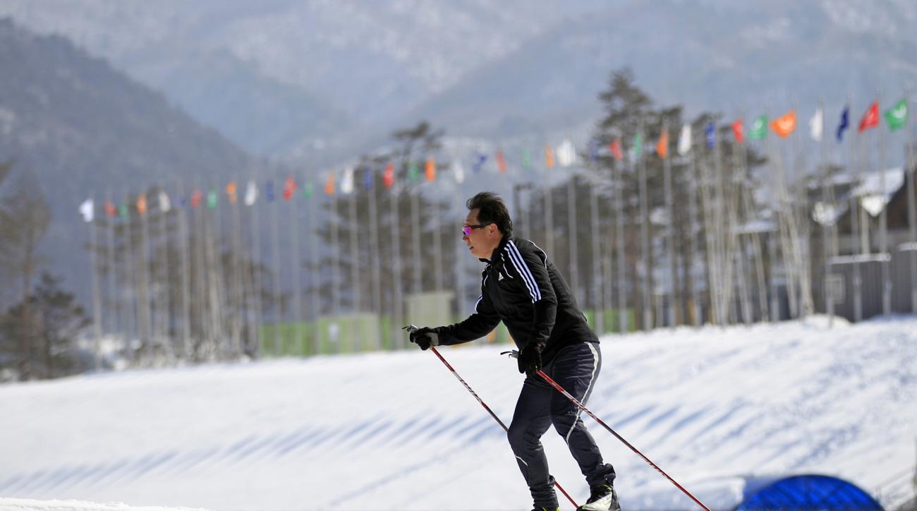 FILE - In this Feb. 19, 2011 file photo, a man skies at the biathlon venue for the Pyeongchang 2018 Winter Olympics in Pyeongchang, east of Seoul, South Korea. The people of Pyeongchang can confidently promise two things when they host the Olympics: it'll be cold, and there'll be no concerns about snow. While a warm spell has created challenging conditions for the skiers and snowboarders competing in the mountains above Sochi at the 2014 edition, there's been heavy dumps of snow in the region that will host the next Winter Games in 2018. (AP Photo/ Lee Jin-man, File)