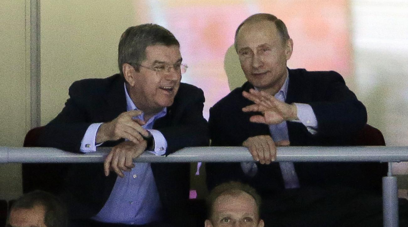 Russian President Vladimir Putin watches the USA Russia men's hockey game from a box at the 2014 Winter Olympics, Saturday, Feb. 15, 2014, in Sochi, Russia. (AP Photo/David J. Phillip )