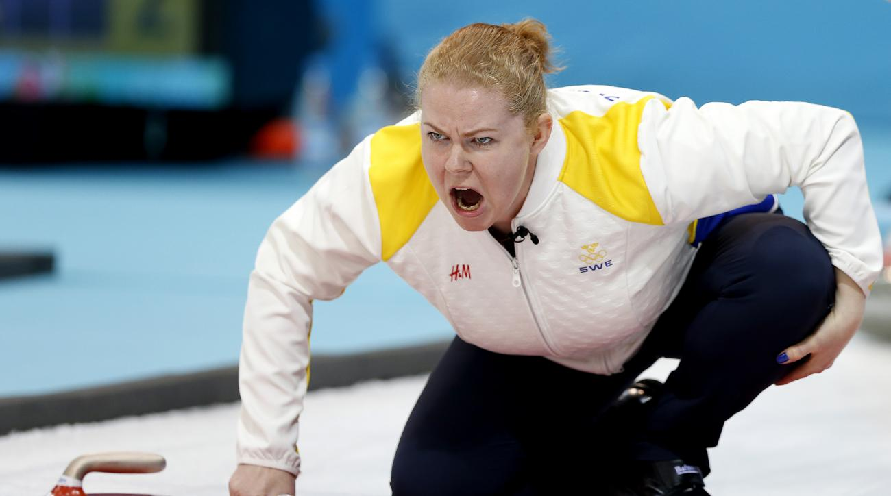 Sweden's Margaretha Sigfridsson shouts instructions to her teammates during the women's curling competition against the United States at the 2014 Winter Olympics, Saturday, Feb. 15, 2014, in Sochi, Russia. (AP Photo/Wong Maye-E)