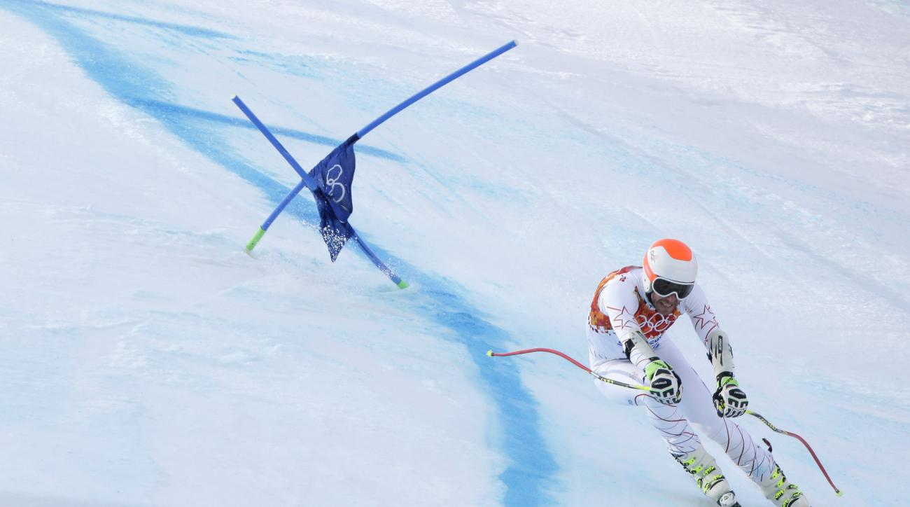 Joint bronze medal winner Bode Miller of the United States passes a gate in the men's super-G the Sochi 2014 Winter Olympics, Sunday, Feb. 16, 2014, in Krasnaya Polyana, Russia. (AP Photo/Charlie Riedel)