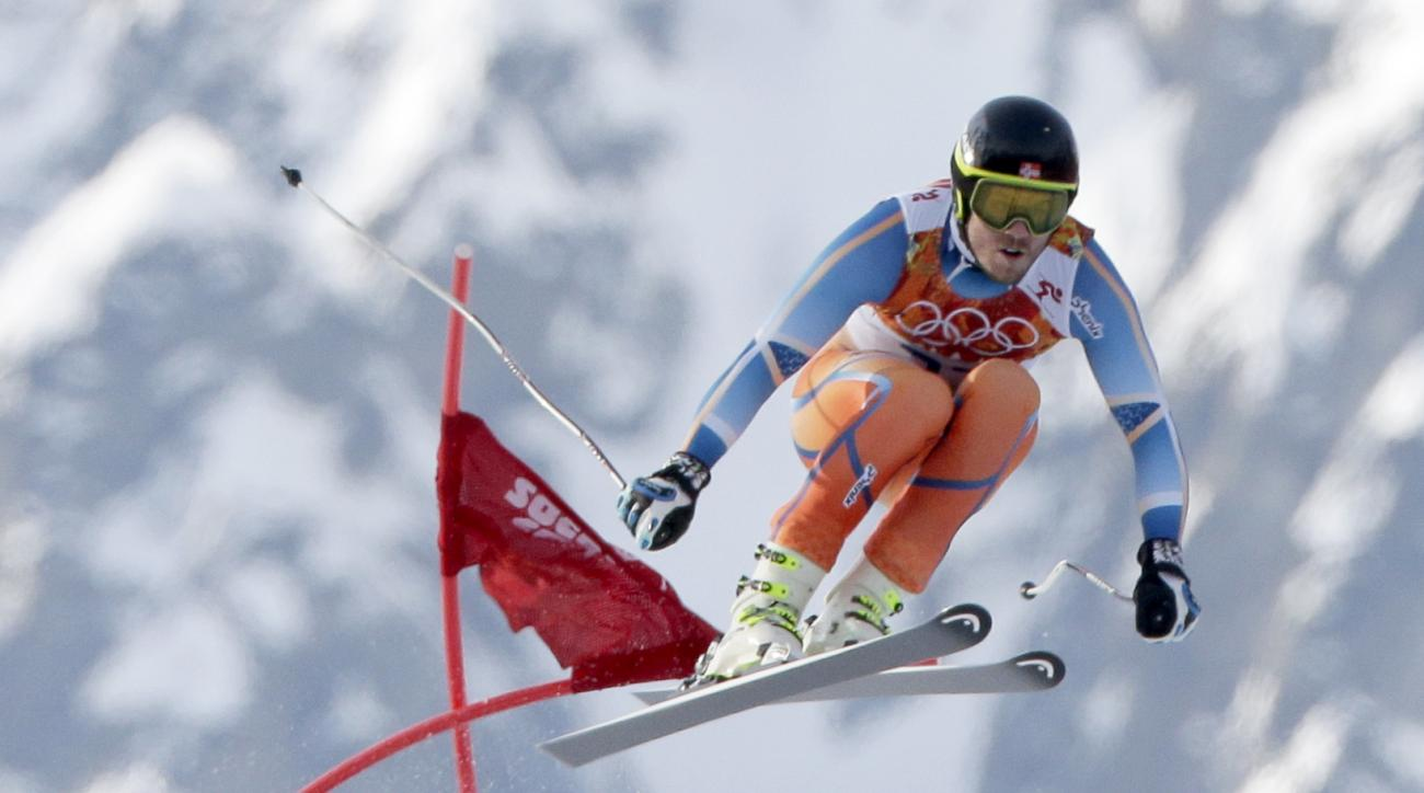 Norway's Kjetil Jansrud makes a jump to win the gold medal in the men's super-G at the Sochi 2014 Winter Olympics, Sunday, Feb. 16, 2014, in Krasnaya Polyana, Russia.(AP Photo/Charlie Riedel)