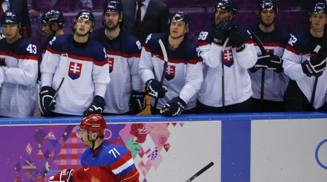 Russia forward Ilya Kovalchuk skates by the Slovakian bench after scoring the winning goal in a shootout of a men's ice hockey game at the 2014 Winter Olympics, Sunday, Feb. 16, 2014, in Sochi, Russia. Russia won 1-0. (AP Photo/Julio Cortez)