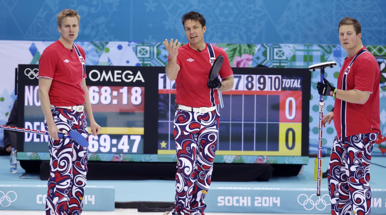 Norway's skip Thomas Ulsrud, center, questions his next delivery along with his sweepers Haavard Vad Petersson, left, and Christoffer Svae during men's curling competition against Denmark at the 2014 Winter Olympics, Monday, Feb. 17, 2014, in Sochi, Russia. (AP Photo/Robert F. Bukaty)