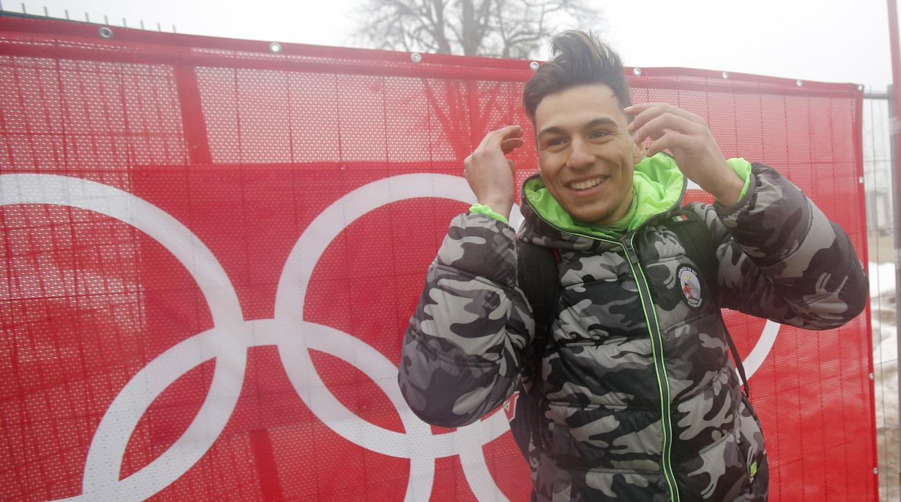 East Timor's Yohan Goncalves Goutt poses for a photo at the Sochi 2014 Winter Olympics, Monday, Feb. 17, 2014, in Krasnaya Polyana, Russia. Goncalves Goutt, 19, is preparing to compete as an Alpine skier in the Sochi Games, representing East Timor, whose officially recognized ski federation he founded. His race, the slalom, is Saturday night. (AP Photo/Christophe Ena)
