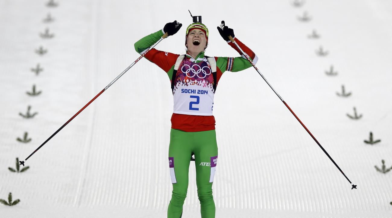 Belarus' Darya Domracheva celebrates winning the gold medal in the women's biathlon 12.5k mass-start, at the 2014 Winter Olympics, Monday, Feb. 17, 2014, in Krasnaya Polyana, Russia. (AP Photo/Kirsty Wigglesworth)