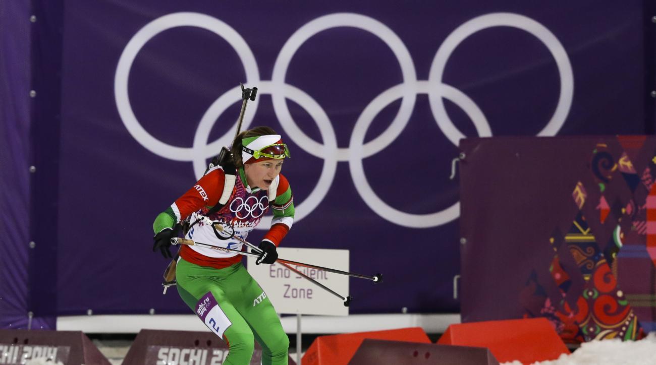 Belarus' Darya Domracheva skies on her way to win the gold medal in the women's biathlon 12.5k mass-start, at the 2014 Winter Olympics, Monday, Feb. 17, 2014, in Krasnaya Polyana, Russia. (AP Photo/Kirsty Wigglesworth)