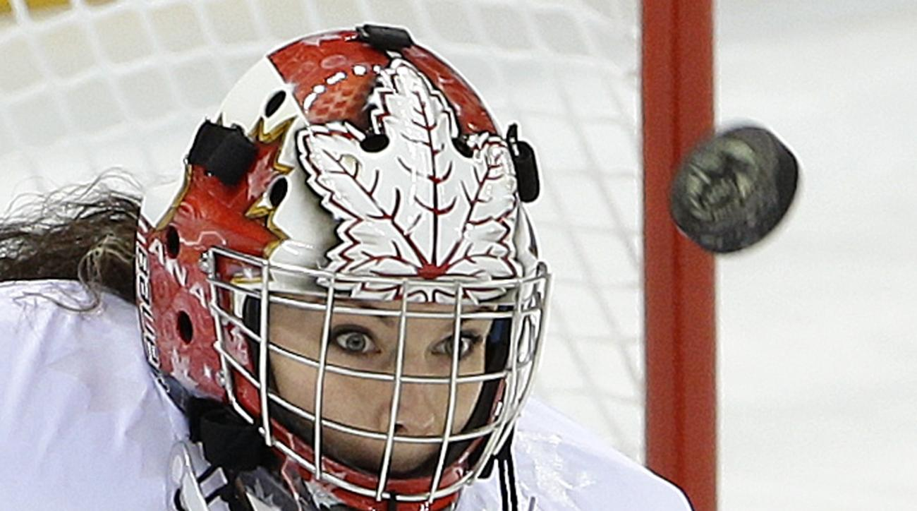 Goalkeeper Shannon Szabados of Canada looks for the rebound on a blocked shot against Switzerland during the first period of the 2014 Winter Olympics women's semifinal ice hockey game at Shayba Arena, Monday, Feb. 17, 2014, in Sochi, Russia. (AP Photo/Matt Slocum)