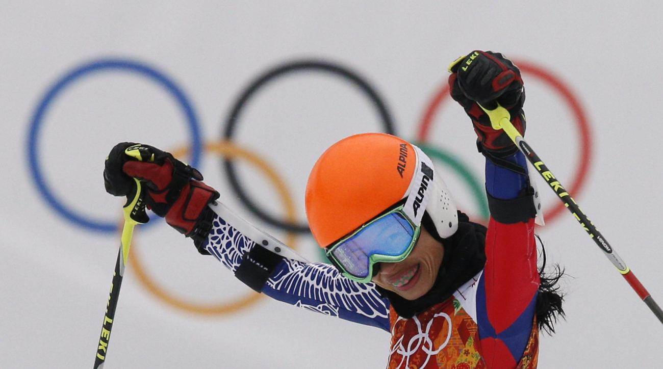 Violinst Vanessa Mae starting under her father name as Vanessa Vanakorn for Thailand celebrates after completing the first run of the women's giant slalom at the Sochi 2014 Winter Olympics, Tuesday, Feb. 18, 2014, in Krasnaya Polyana, Russia.(AP Photo/Christophe Ena)
