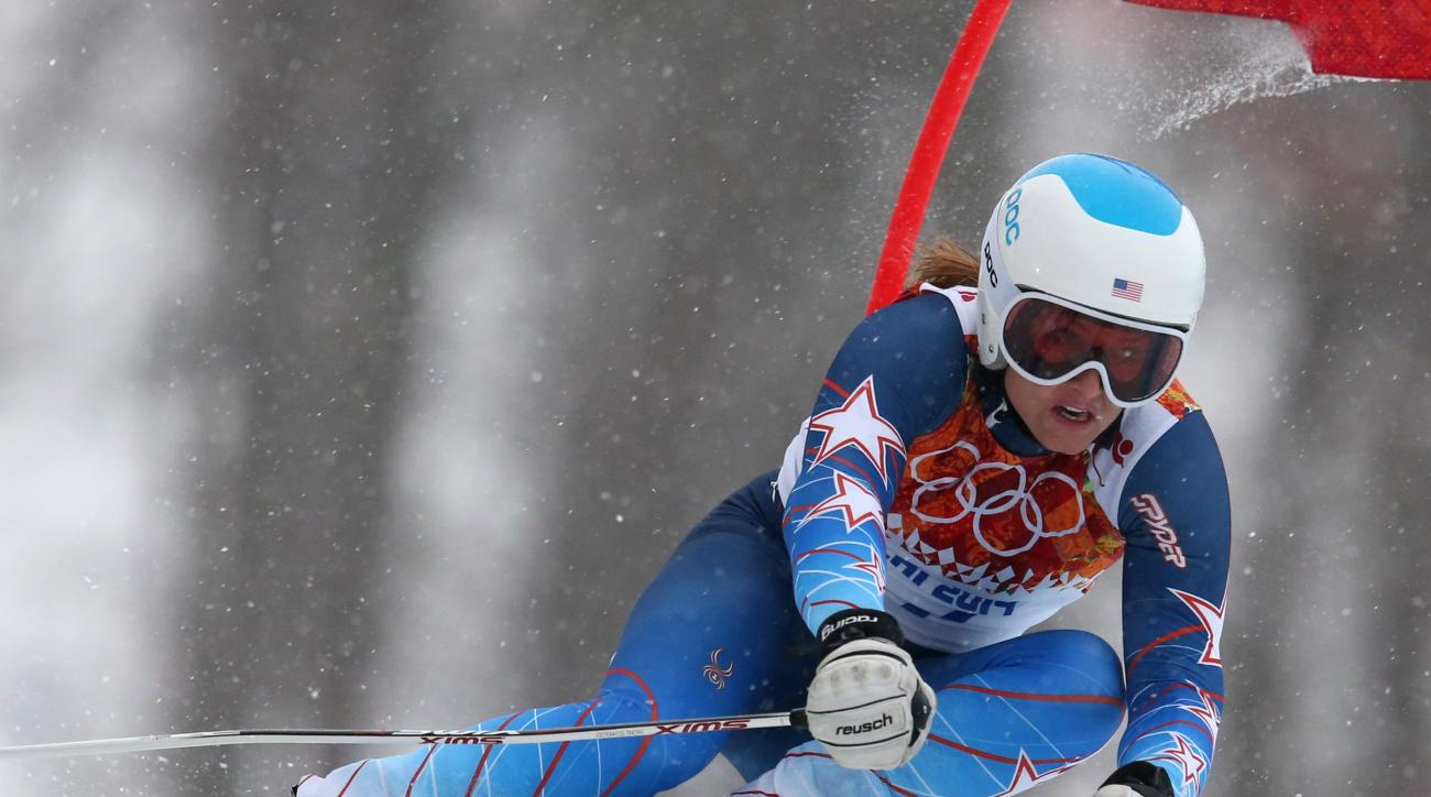 United States' Julia Mancuso passes a gate in the first run of the women's giant slalom at the Sochi 2014 Winter Olympics, Tuesday, Feb. 18, 2014, in Krasnaya Polyana, Russia. (AP Photo/Alessandro Trovati)