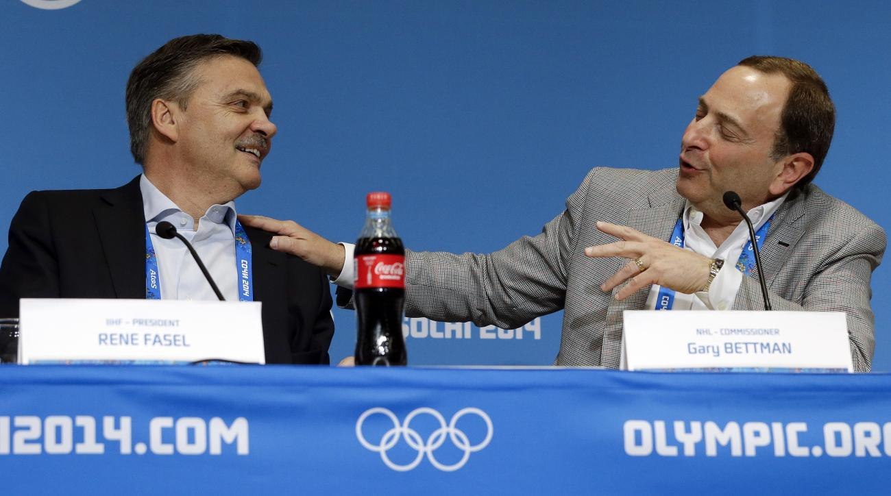 NHL Commissioner Gary Bettman, right, and International Ice Hockey Federation President Rene Fasel, left, answer questions at a news conference at the 2014 Winter Olympics, Tuesday, Feb. 18, 2014, in Sochi, Russia. (AP Photo/Mark Humphrey)