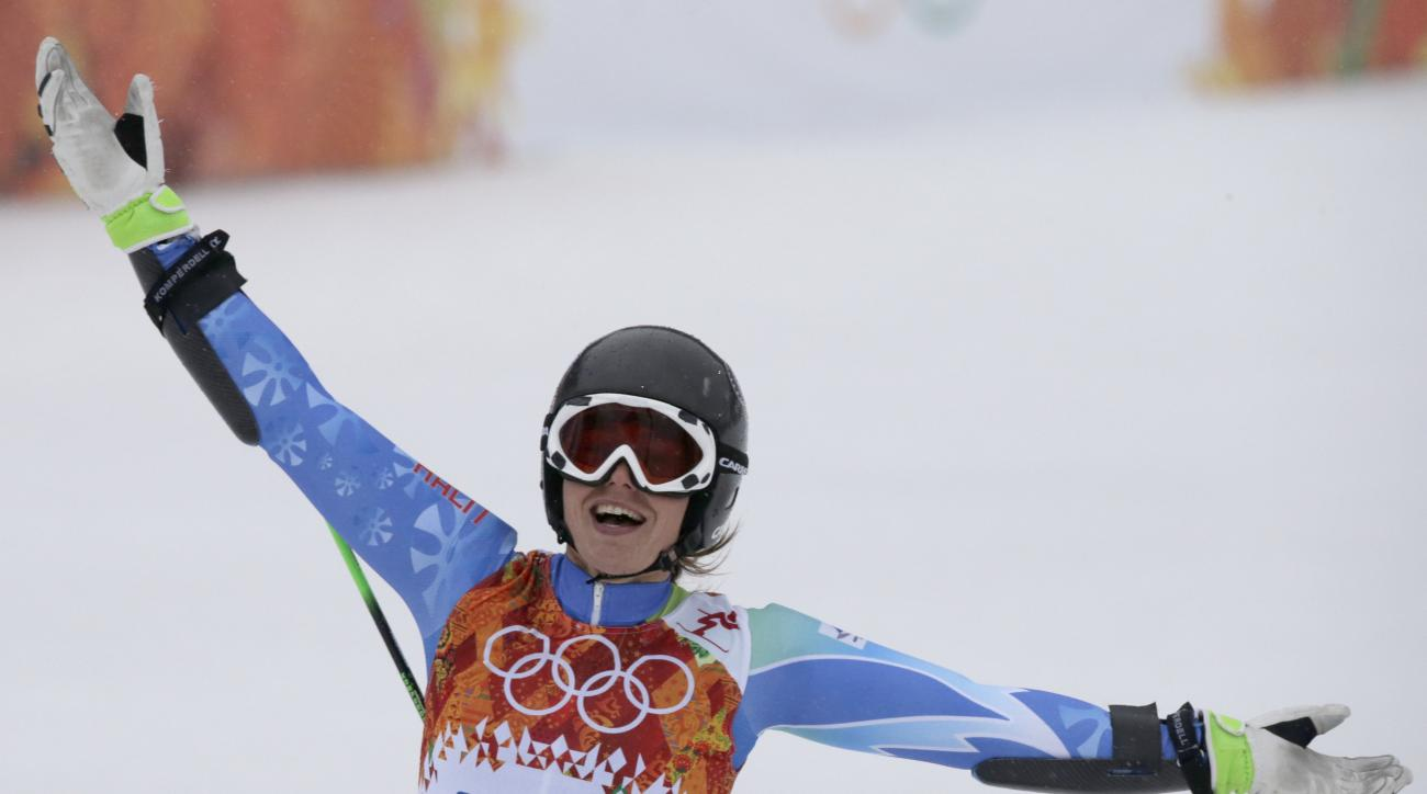 Slovenia's Tina Maze celebrates taking the lead in the second run of the women's giant slalom at the Sochi 2014 Winter Olympics, Tuesday, Feb. 18, 2014, in Krasnaya Polyana, Russia. (AP Photo/Gero Breloer)