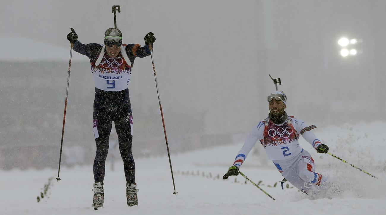 Norway's Emil Hegle Svendsen, left, outsprints France's Martin Fourcade to win the men's biathlon 15k mass-start, at the 2014 Winter Olympics, Tuesday, Feb. 18, 2014, in Krasnaya Polyana, Russia. (AP Photo/Felipe Dana)