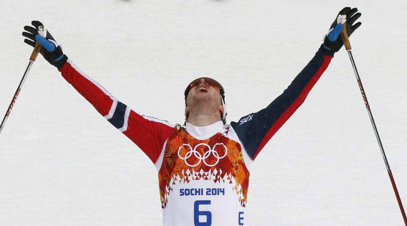 Norway's Joergen Graabak crosses the finish line to win the gold during the Nordic combined individual Gundersen large hill competition at the 2014 Winter Olympics, Tuesday, Feb. 18, 2014, in Krasnaya Polyana, Russia. (AP Photo/Dmitry Lovetsky)