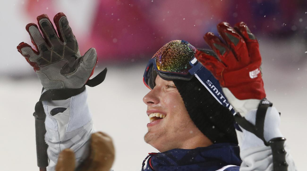David Wise of the United States reacts after learning he won the gold medal in the men's ski halfpipe final at the Rosa Khutor Extreme Park, at the 2014 Winter Olympics, Tuesday, Feb. 18, 2014, in Krasnaya Polyana, Russia.  (AP Photo/Sergei Grits)
