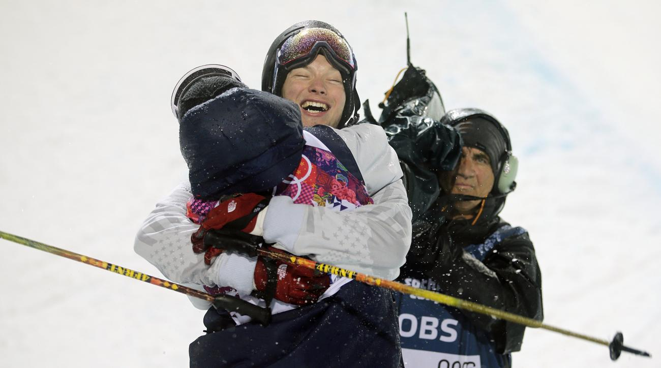Gold medalist David Wise, facing camera, of the United States, is congratulated by Aaron Blunck, also of the United States, after the men's ski halfpipe final at the Rosa Khutor Extreme Park, at the 2014 Winter Olympics, Tuesday, Feb. 18, 2014, in Krasnaya Polyana, Russia. (AP Photo/Jae C. Hong)