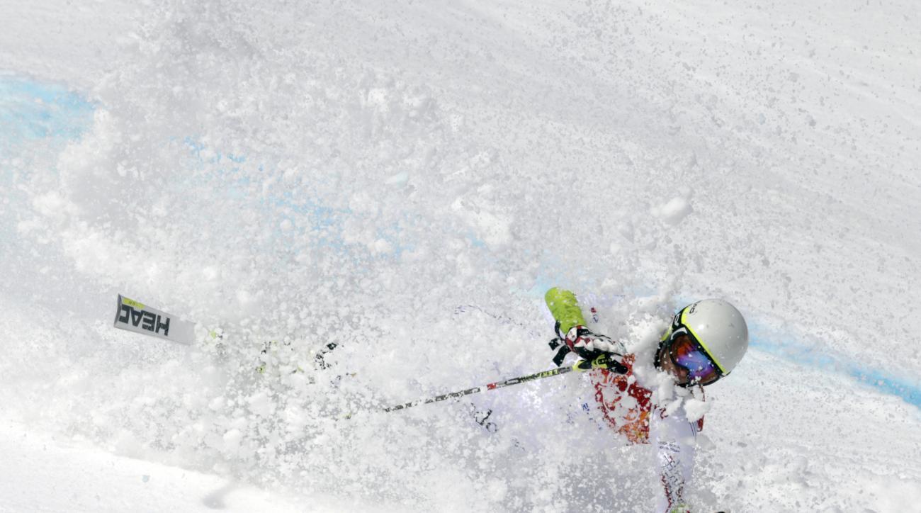 Andorra's Joan Verdu Sanchez crashes in the first run of the men's giant slalom at the Sochi 2014 Winter Olympics, Wednesday, Feb. 19, 2014, in Krasnaya Polyana, Russia. (AP Photo/Charles Krupa)