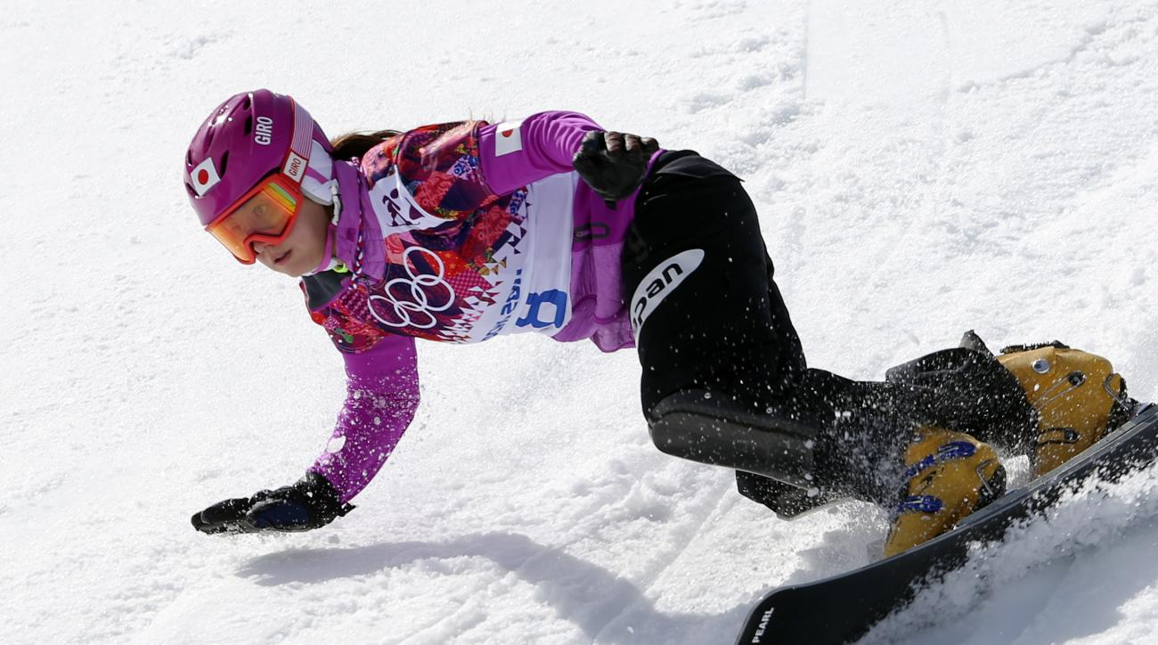 Japan's Tomoka Takeuchi competes during women's snowboard parallel giant slalom heats at the Rosa Khutor Extreme Park, at the 2014 Winter Olympics, Wednesday, Feb. 19, 2014, in Krasnaya Polyana, Russia. (AP Photo/Sergei Grits)