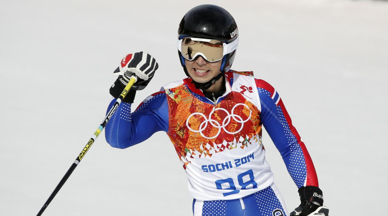 Thailand's Kanes Sucharitakul reacts after finishing the first run of the men's giant slalom the Sochi 2014 Winter Olympics, Wednesday, Feb. 19, 2014, in Krasnaya Polyana, Russia. (AP Photo/Christophe Ena)