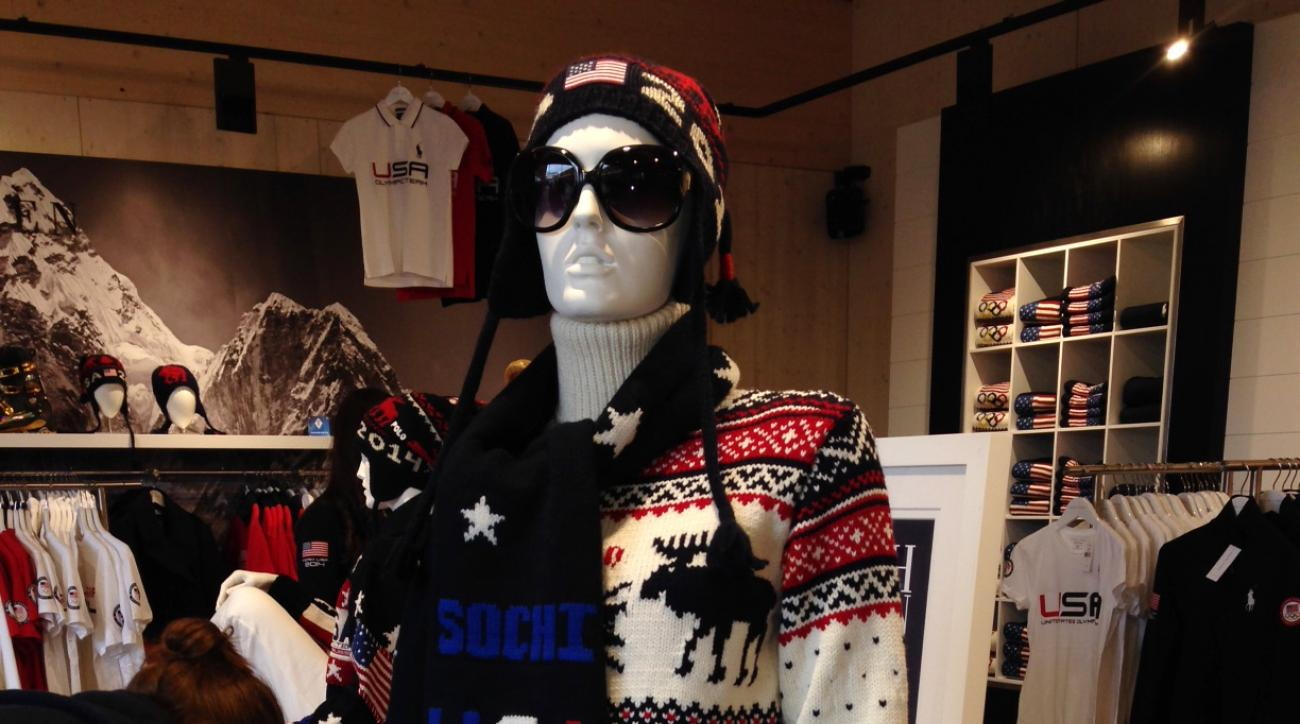 A mannequin wears a wool sweater, scarf and hat by American designer Ralph Lauren in the pop-up shop at USA House in Olympic Park in Sochi, Russia, on Wednesday, Feb. 19, 2014. The shop sells some of the same clothing worn by American athletes in the Olympic opening ceremony, along with USA Hockey gear. (AP Photo/Beth Harris)
