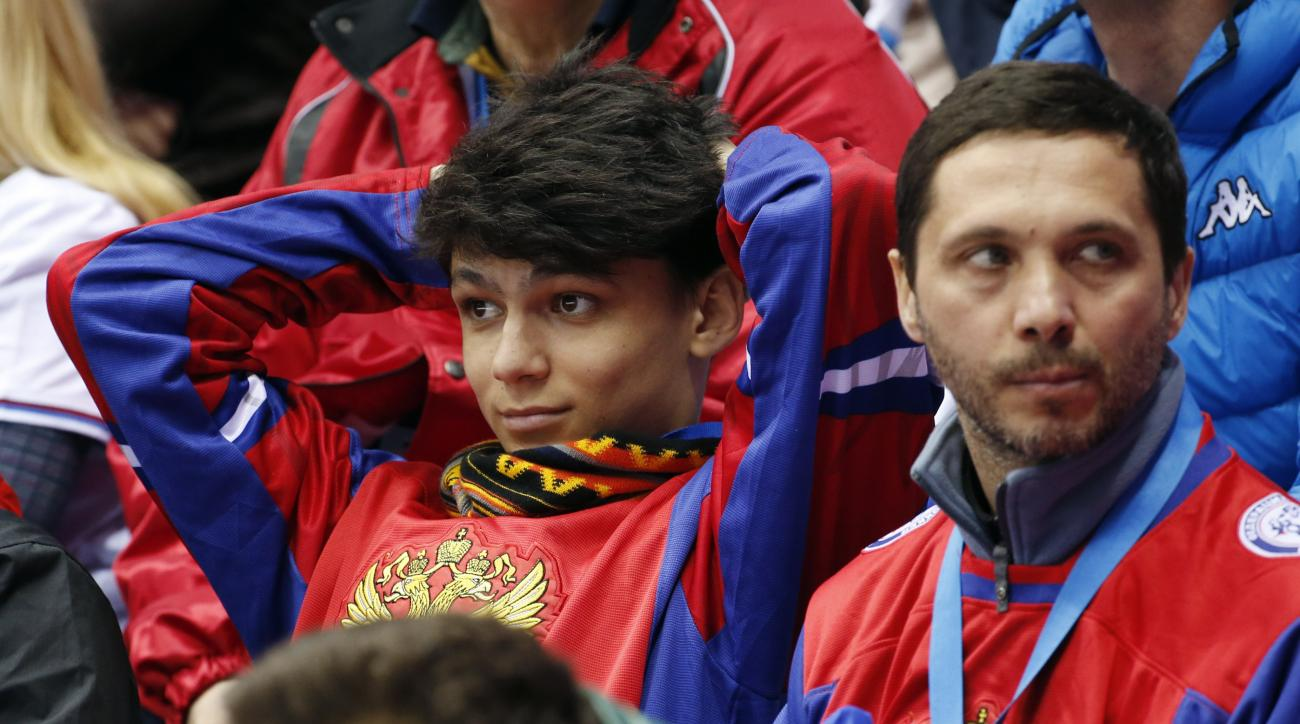 Russian hockey fans react after a goal by Finland against Russia in the second period of a men's quarterfinal ice hockey game at the 2014 Winter Olympics, Wednesday, Feb. 19, 2014, in Sochi, Russia. (AP Photo/Julio Cortez)