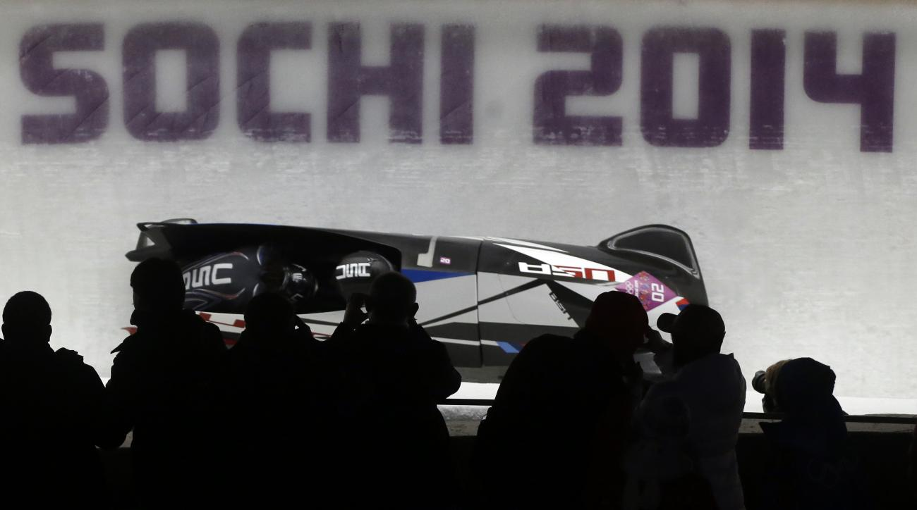 The team from the United States USA-1, piloted by Elana Meyers with brakeman Lauryn Williams, take a curve in the third run during the women's bobsled competition at the 2014 Winter Olympics, Wednesday, Feb. 19, 2014, in Krasnaya Polyana, Russia. (AP Photo/Dita Alangkara)