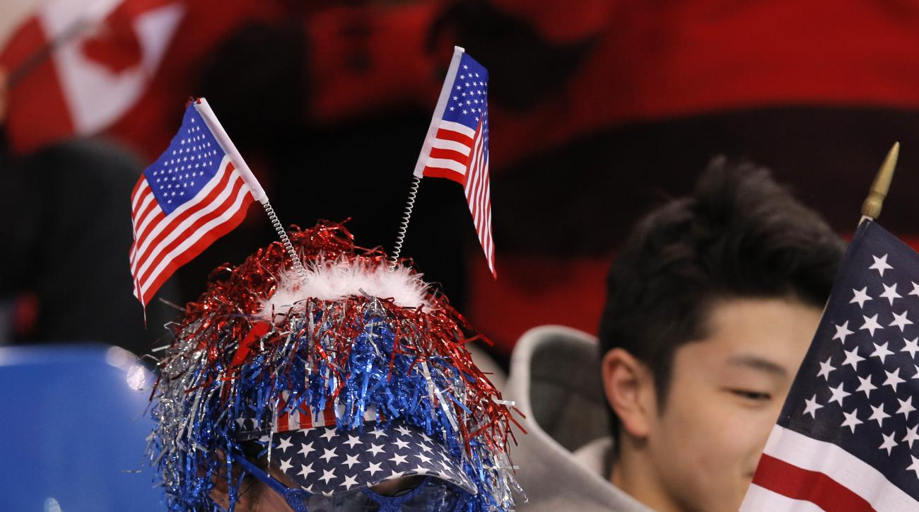 Jason Brown of the United States watches the women's short program figure skating competition at the Iceberg Skating Palace during the 2014 Winter Olympics, Wednesday, Feb. 19, 2014, in Sochi, Russia. (AP Photo/Vadim Ghirda)