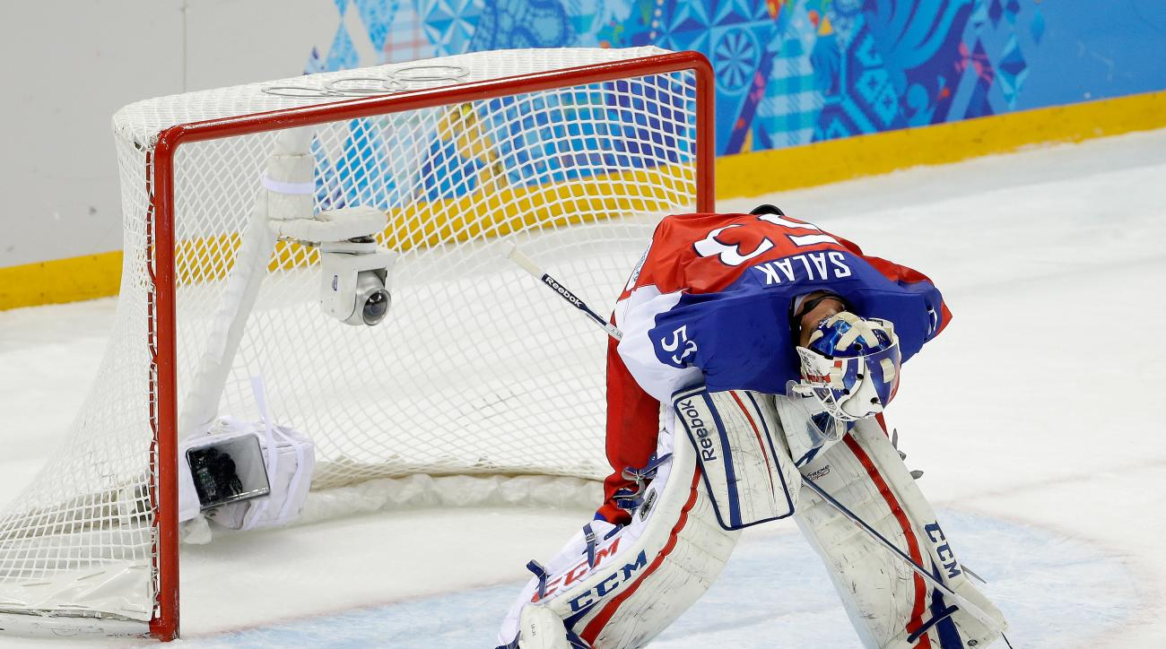 Czech Republic goaltender Alexander Salak looks down at the ice after the team's 5-2 loss to the United States in the men's quarterfinal hockey game in Shayba Arena at the 2014 Winter Olympics, Wednesday, Feb. 19, 2014, in Sochi, Russia. (AP Photo/Matt Slocum)