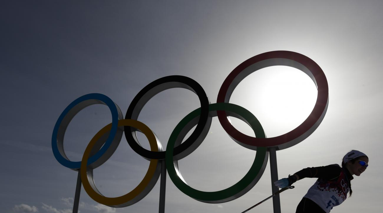 A skier passes by the olympic rings at the Laura Cross-country Ski & Biathlon Center during a training session at the 2014 Winter Olympics, Thursday, Feb. 20, 2014, in Krasnaya Polyana, Russia. (AP Photo/Felipe Dana)