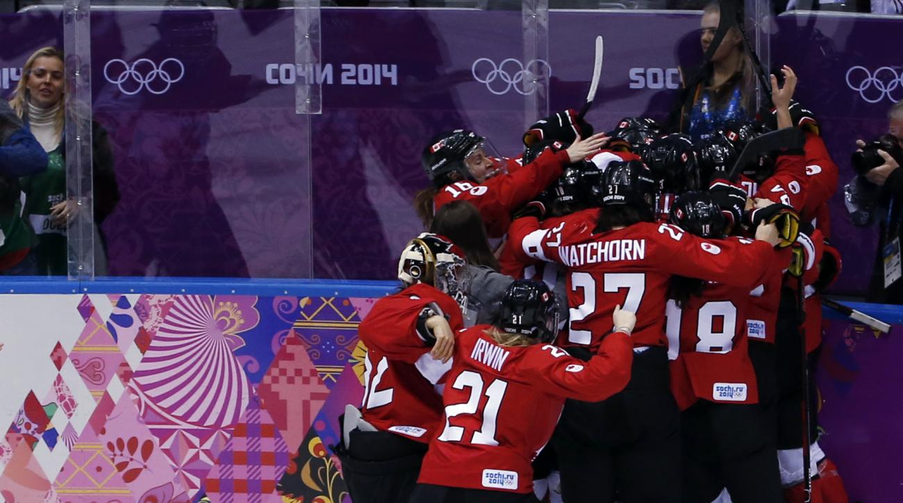 Anne Schleper of the United States (15) reacts after the women's gold medal ice hockey game against Canada at the 2014 Winter Olympics, Thursday, Feb. 20, 2014, in Sochi, Russia. (AP Photo/Petr David Josek)
