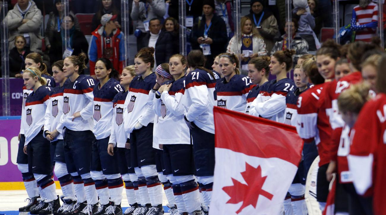 Team USA awaits their silver medals after losing 3-2 in overtime to Canada in the women's gold medal ice hockey game at the 2014 Winter Olympics, Friday, Feb. 21, 2014, in Sochi, Russia. (AP Photo/Mark Humphrey)