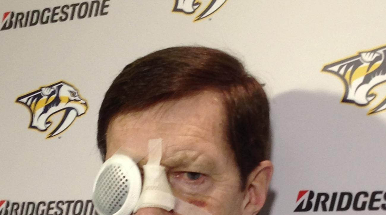 David Poile, general manager of the U.S. hockey team and of theNashville Predators, speaks to reporters Thursday, Feb. 20, 2014, in Nashville, Tenn., for first time since taking an errant puck to the face Feb. 6. His injuries kept him from traveling to Sochi, and he says he currently cannot see out if his right eye. (AP Photo/Teresa Walker)