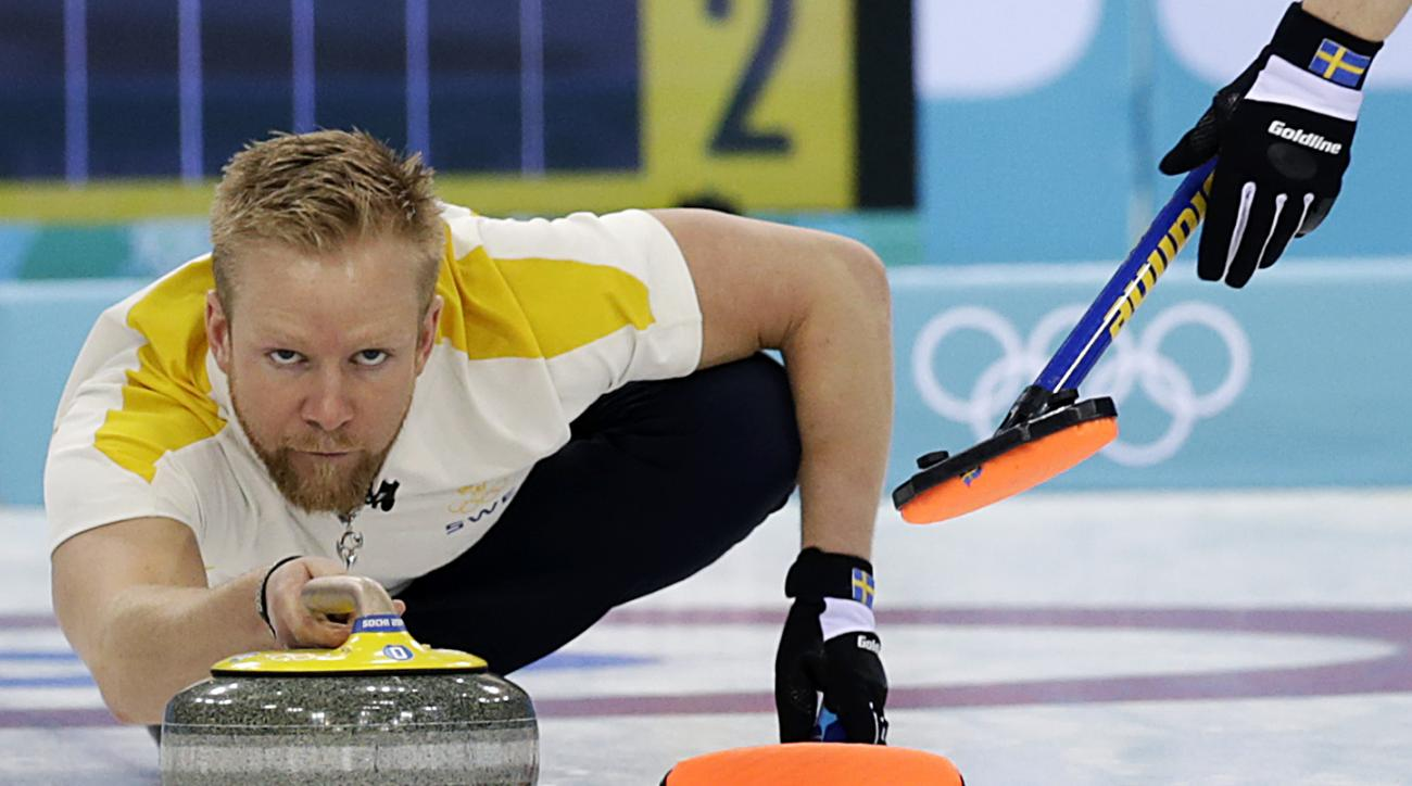 Sweden's skip Niklas Edin, delivers the rock during the men's curling bronze medal game against China at the 2014 Winter Olympics, Friday, Feb. 21, 2014, in Sochi, Russia. (AP Photo/Wong Maye-E)