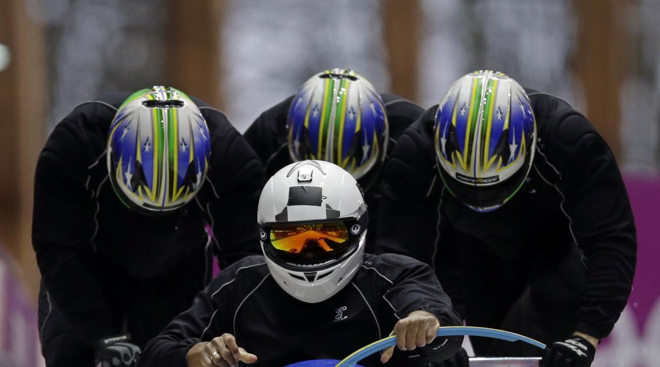 The team from Brazil BRA-1, piloted by Edson Bindilatti, start a run during the men's four-man bobsled training at the 2014 Winter Olympics, Friday, Feb. 21, 2014, in Krasnaya Polyana, Russia. (AP Photo/Dita Alangkara)