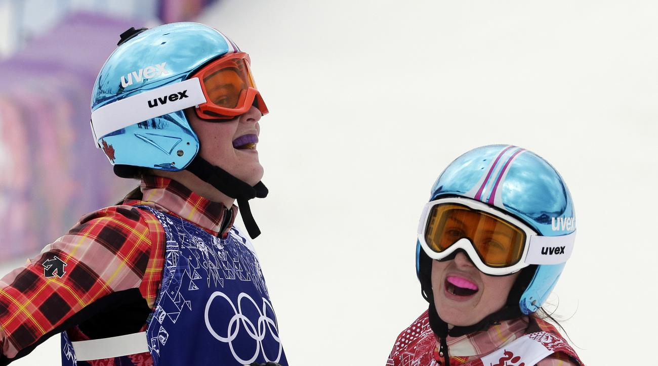 Canada's Marielle Thompson, left, celebrates after winning the gold medal ahead of silver medalist and compatriot Kelsey Serwa, right, in the women's ski cross final at the Rosa Khutor Extreme Park, at the 2014 Winter Olympics, Friday, Feb. 21, 2014, in Krasnaya Polyana, Russia. (AP Photo/Andy Wong)