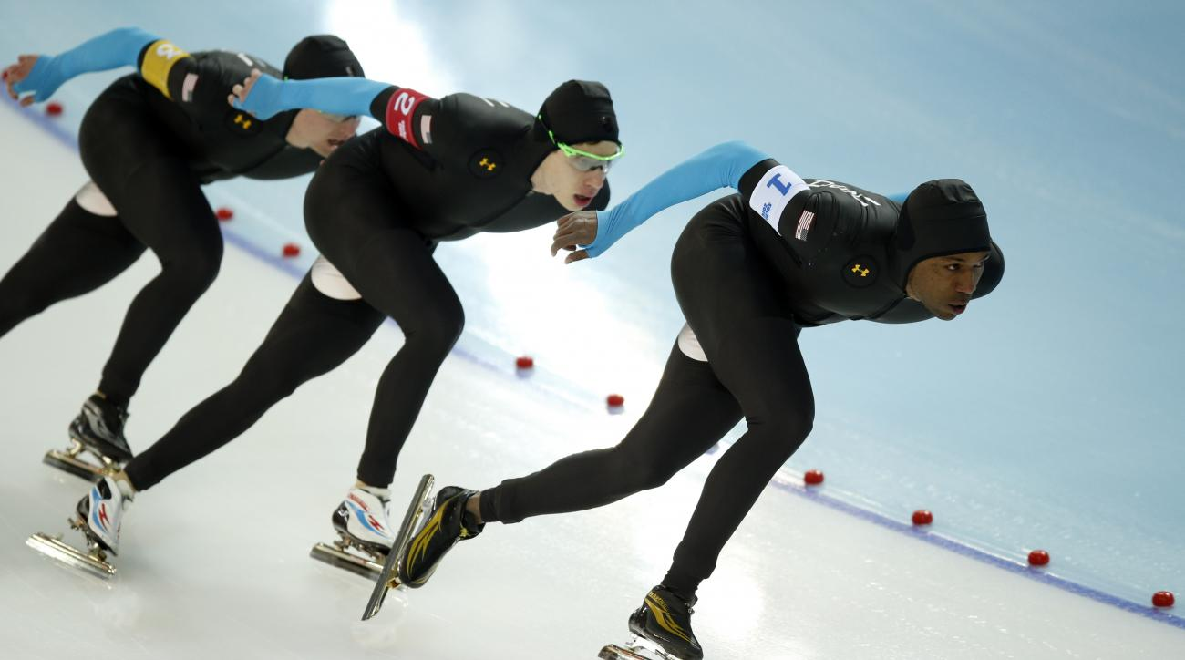 The U.S. speedskating team, left to right, Jonathan Kuck, Brian Hansen and Shani Davis compete in the men's speedskating team pursuit quarterfinals at the Adler Arena Skating Center during the 2014 Winter Olympics in Sochi, Russia, Friday, Feb. 21, 2014.  (AP Photo/Pavel Golovkin)
